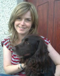 Lady holding brown springer spaniel dog